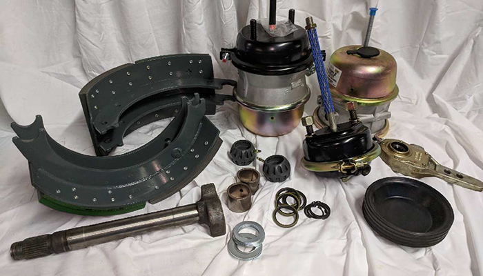 Image showing brake shoes, slacks, chambers and cam shafts for HD trucks available at Dias Spring Service.